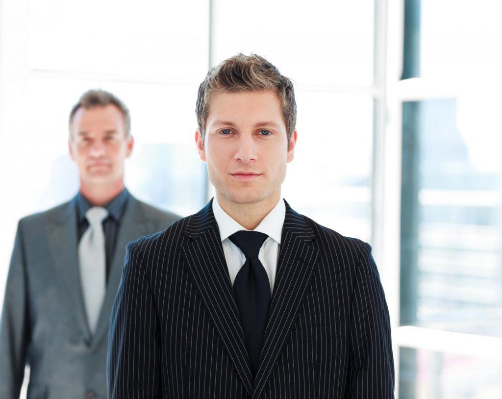 two men standing posing